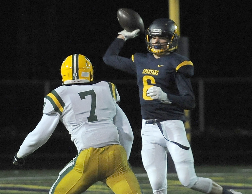 . Colton Haberek (6) of Fitzgerald carries the ball in a first quarter play during the match between Harrison and Fitzgerald on October 27, 2017. THE MACOMB DAILY PHOTO GALLERY BY DAVID DALTON