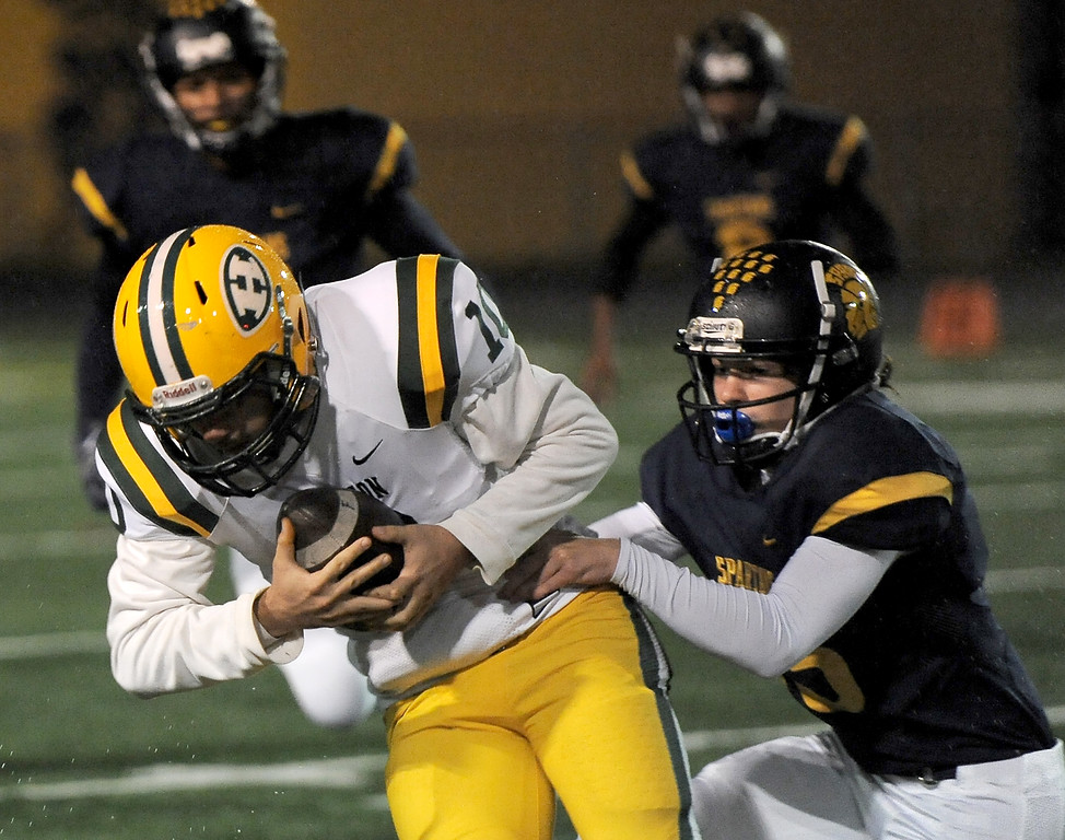 . Victor Mencotti (10) of Harrison carries the ball in a first quarter play during the match between Harrison and Fitzgerald on October 27, 2017. THE MACOMB DAILY PHOTO GALLERY BY DAVID DALTON