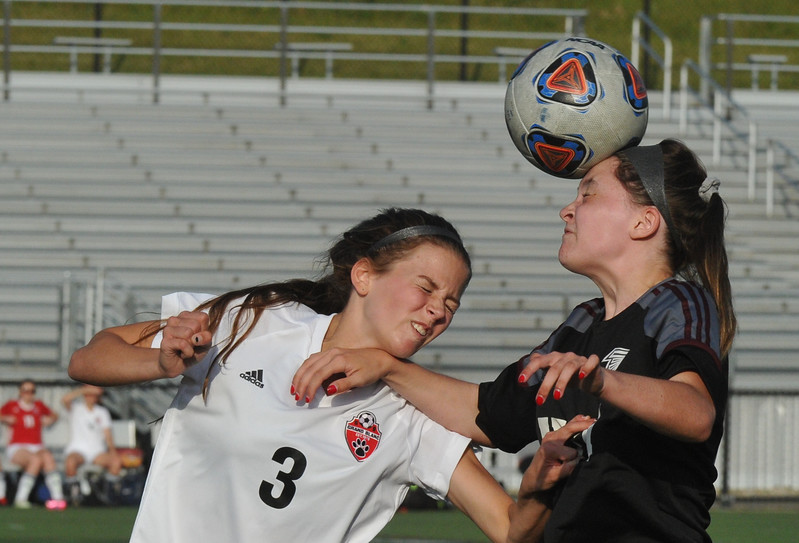 Henry Ford's Nicole Fiantaco (R) heads the ball away from Grand Blanc's Lexi Childers (3) during the MHSAA D1 Semi-final played on Wednesday June 14, 2017 at Stoney Creek HS.  The Falcons lost to the Bobcats 2-1.  (MIPrepZone photo by Ken Swart)