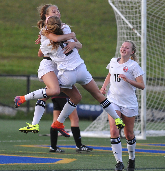 Sisters Paige (2) and Faith Webber celebrate  the winning goal that Faith scored on an assist from Paige as teammate Ashton Cassel looks on during the MHSAA D1 Semi-final against Henry Ford held on Wednesday June 14, 2017 at Stoney Creek High School.  The Bobcats defeated the Falcons 2-1 to win the title. (MIPrepZone photo by Ken Swart)
