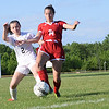 Julia Jones, left, of L'Anse Creuse North and Anchor Bay's Isabella Hunter go for the ball during the first half of a Division 1 district match. The Tars won on penalty kicks.