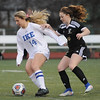 Gabriala Jodzis (14) of Eisenhower and Kassandra Witherspoon (10) of L'Anse Creuse North battle for control of the ball during the match between L'Anse Creuse North and Eisenhower on March 27, 2017. (MIPrepZone photo gallery by David Dalton)