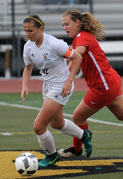 Sabrina Weir (11) of L'Anse Creuse North moves the ball down the field during the match between Romeo and L'Anse Creuse North on May 24, 2017.  (MIPrepZone photo gallery by David Dalton)