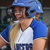 It's all smiles for L'Anse Creuse's Sammi Mills after she cranked out her second homer of the game against L'Anse Creuse North. The Lancers beat the Crusaders, 9-7. (MIPrepZone photo gallery by Chuck Pleiness)