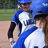 L'Anse Creuse's Brooke Nadolny is greeted at home plate after hitting her third solo homer in a 9-7 win over L'Anse Creuse North. (MIPrepZone photo gallery by Chuck Pleiness)