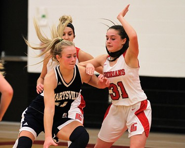 Kara Wolfbauer (31) of Lake Shore defends Marysvilles Gabby Fogarty. Marysville traveled to Lake Shore for a MAC Gold contest on January 7, 2019. Digital First Media photo gallery by George Spiteri.