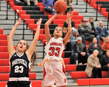 Alexis Stacy (33) of Lake Shore goes up for a shot. Marysville traveled to Lake Shore for a MAC Gold contest on January 7, 2019. Digital First Media photo gallery by George Spiteri.
