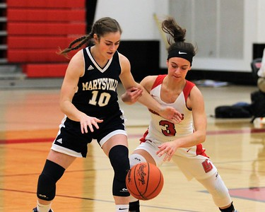 Olivia May (10) of Marysville and Rose Manzella (3) of Lake Shore go after a loose ball. Marysville traveled to Lake Shore for a MAC Gold contest on January 7, 2019. Digital First Media photo gallery by George Spiteri.