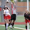 Roseville sophomore goalkeeper Lauren Orler reaches up to deflect a shot in the first half against Lake Shore. (Photo by Bill Roose)