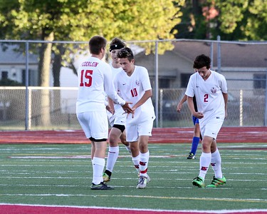 Lake Shore's Chris Federlein (15) congratulates Matthew Rach (10) after Rach put the Shorian's up 1-0 over Warren Woods-Tower midway through the first half. Lake Shore defeated Warren Woods-Tower 5-4 in a MAC Gold contest played at Lake Shore on Monday, October 2, 2017. Macomb Daily photo gallery by George Spiteri.