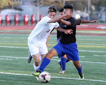 Matthew Rach of Lake Shore battles Billy Lee of Warren Woods-Tower during first half play. Lake Shore defeated Warren Woods-Tower 5-4 in a MAC Gold contest played at Lake Shore on Monday, October 2, 2017. Macomb Daily photo gallery by George Spiteri.