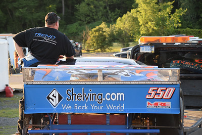 Terry Bogusz rides on a flatbed truck with his damaged Late Model race car after an accident at Flat Rock Speedway. Bogusz, a Shelby Township resident, started the race on the pole position.