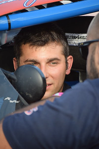 Frank Jiovani talks to a crew member before qualifying for a race at Flat Rock Speedway.