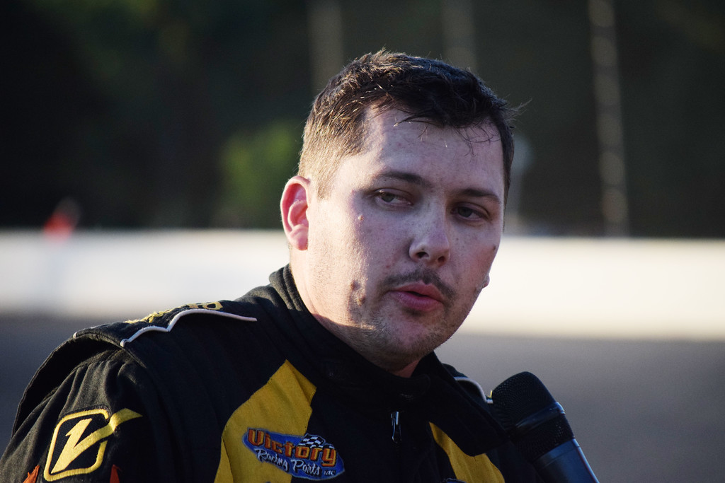 . Justin Schroeder of Westland is interviewed after winning the ARCA Moran Chevrolet Late Model race at Flat Rock Speedway on July 8.