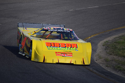 Justin Schroeder drives through turn 1. The Westland resident has won four of the five Late Model races at Flat Rock this season.