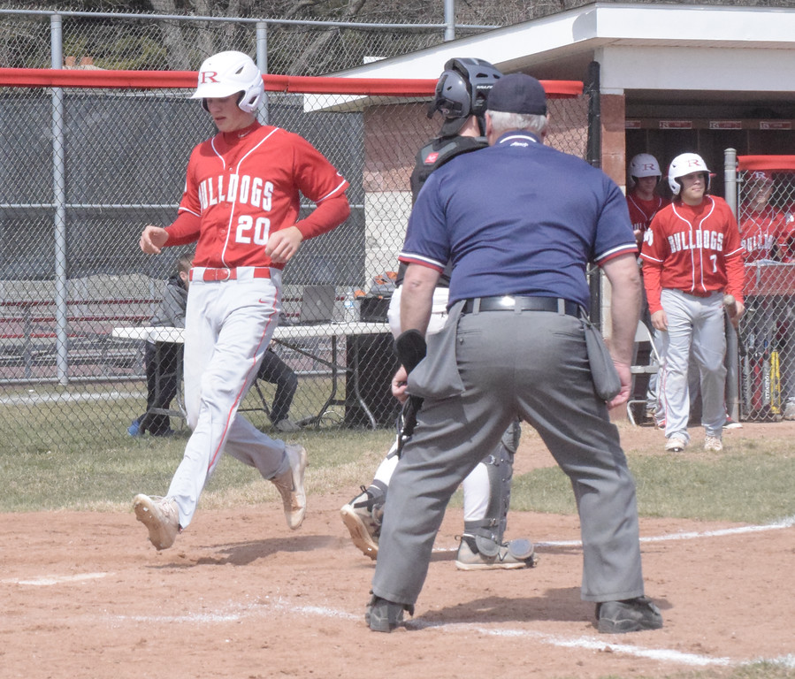 . Matt Staelgrave scores to put Romeo ahead 2-1 in the bottom of the third inning of a non-league game against Lutheran North. Staelgrave had a hit in a two-run rally in the seventh as the Bulldogs won 5-4.