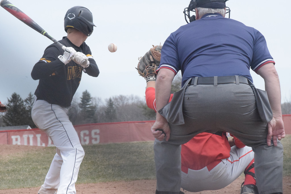 . Noah Fiehn of Lutheran North looks over a Romeo pitch during the top of the seventh inning.
