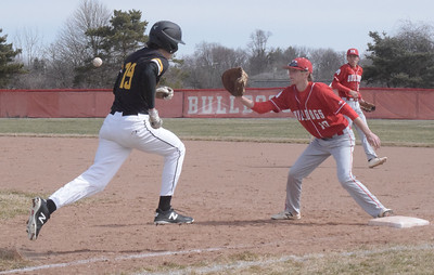 Tyler Trammel of Lutheran North is retired at first base as Kaden Stively of Romeo takes a throw during a non-league game won by the Bulldogs 5-4.