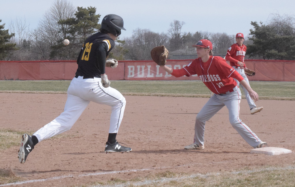 . Tyler Trammel of Lutheran North is retired at first base as Kaden Stively of Romeo takes a throw during a non-league game won by the Bulldogs 5-4.