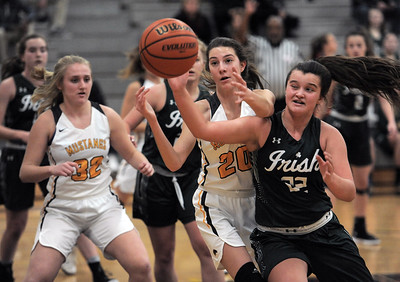 Julia Zauel (20) of Lutheran North attempts to rebound the ball from Rileigh Garbarz (22) of Gabriel Richard during the match between Lutheran North and Gabriel Richard on December 4, 2019.THE MACOMB DAILY PHOTO GALLERY BY DAVID DALTON