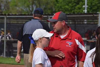 Cousino coach Mike Rocheleau talks to his players between innings of Tuesday afternoon's MAC Gold game against visiting Marysville. (Macomb Daily photo gallery by Jim Evans)
