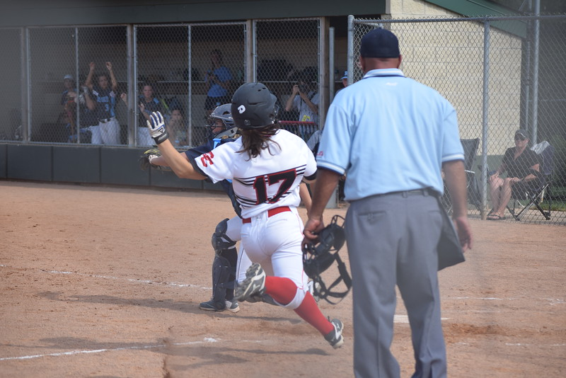 Natalie Santostasi scores for Divine Child to create a 1-1 tie  in the bottom of the fifth inning. (MIPrepZone photo gallery by George Pohly)