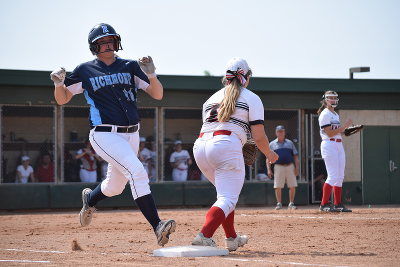 Cameron Barrett of Richmond reaches first base after her ground ball was misplayed by the Divine Child infield in the second inning of a state Division 2 quarterfinal game at Novi. (MIPrepZone photo gallery by George Pohly)