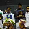 New Haven captains, from left, Eric Williams Jr., A.J. Crawford III and Romeo Weems join coach Tedaro France II with trophies the Rockets won this season, including the state Class B championship trophy.