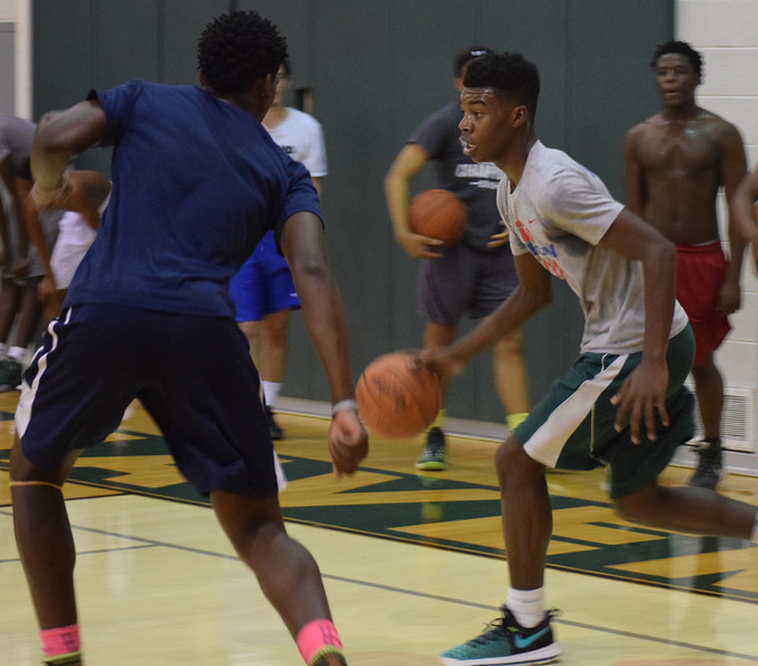 Erik Williams, right, dribbles against Romeo Weems during practice at New Haven. The Rockets are coming off back-to-back regional championship seasons. New Haven held its first practice of the basketball season on Nov. 14, 2016. The Rockets, who won MAC Gold, district and regional championships last season, will be in the MAC Blue in 2016-17.