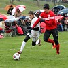 Rocket's Sebastian Petroj (6) battles Marlette's Bryce George during 1st half action. New Haven falls to Marlette 2-0 in their regional soccer game played at Oakland Christian on October 26, 2016. (MIPrepZone photo gallery by George Spiteri)