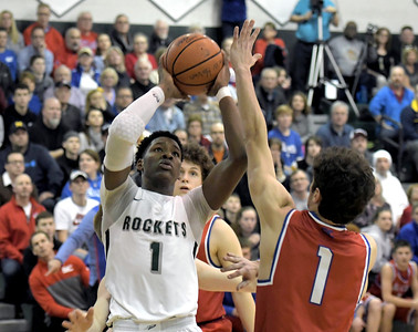 Romeo Weems (1) of New Haven puts up a shot during the match between New Haven and St. Clair on March 12, 2018.  MACOMB DAILY PHOTO GALLERY BY DAVID DALTON