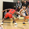 Tyler Markray (2) guards against L'Anse Creuse North junior guard Chris Williams. (Photo by Bill Roose)