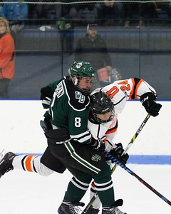 Ethan Gehrke of Utica and Noah Zieman of West Bloomfield battle during the 2nd period at Suburban Ice Arena on Friday, November 17, 2017. Macomb Daily Photo Gallery by George Spiteri.