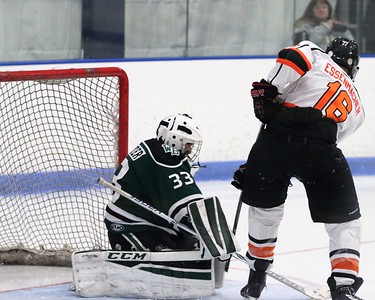 Utica's Zach Essenmacher gets the puck past West Bloomfield goaltender Steven McCotter in the 2nd period to put the Chieftains up 3-1in a game played at Suburban Ice Arena on Friday, November 17, 2017. Macomb Daily Photo Gallery by George Spiteri.