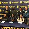 Three Fitzgerald student-athletes will be moving on to play in college. They are (from left to right) Kareem Wallace, football, Kalamazoo College; Mike Kizer, football, Dakota College at Bottineau; and Ashley Bane, softball, Schoolcraft Community College. <br /> Pictured behind the athletes are (from left to right) varsity head football coach Gary Skop; defensive coordinator Juwan Shakespear; varsity softball head coach Rich Smith; and junior varsity softball coach Rob McGuire.