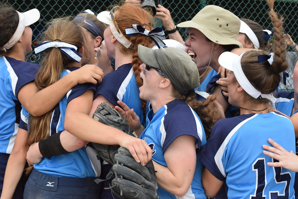 . Regina celebrates  its 13-0 win over Garden City in a Division 1 state quarterfinal game Tuesday at Wayne State University. It\'s the Saddlelites first trip to the state semifinals since they won  the state championship in 2015.