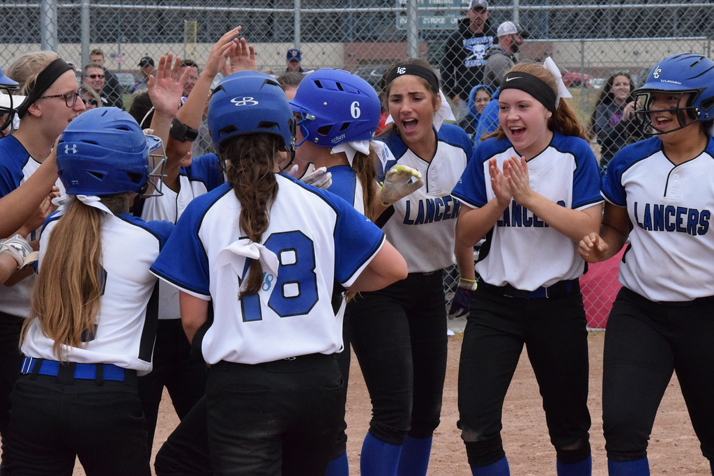 . Regina beats L\'Anse Creuse, 12-11, to win its first Division 1 softball regional championship since 2015 on June 9, 2018. THE MACOMB DAILY PHOTO GALLERY BY CHUCK PLEINESS