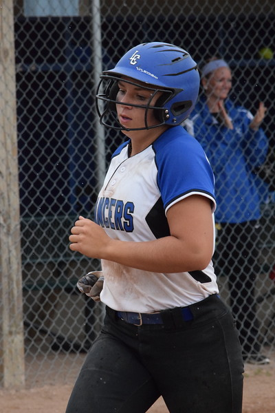Regina beats L'Anse Creuse, 12-11, to win its first Division 1 softball regional championship since 2015 on June 9, 2018. THE MACOMB DAILY PHOTO GALLERY BY CHUCK PLEINESS