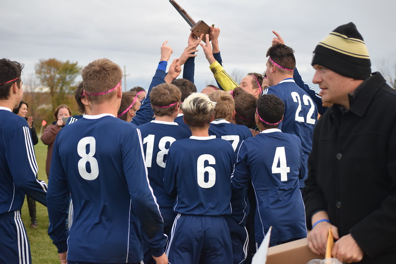 Richmond players celebrate with the championship trophy. Richmond defeated Lutheran North 2-1 in a Division 3 district soccer championship game played Oct. 21, 2016, at Imlay City.  (MIPrepZone photo gallery by George Pohly)