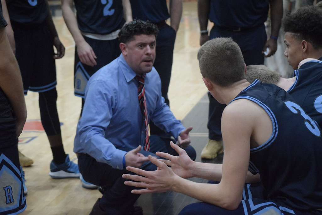 . Richmond coach Josh Presnell makes a point to his team during a first-half timeout. Armada defeated Richmond 55-44 in a key Blue Water Area Conference basketball game played on the Tigers\' floor Tuesday, Feb. 13.  THE MACOMB DAILY PHOTO GALLERY BY GEORGE POHLY