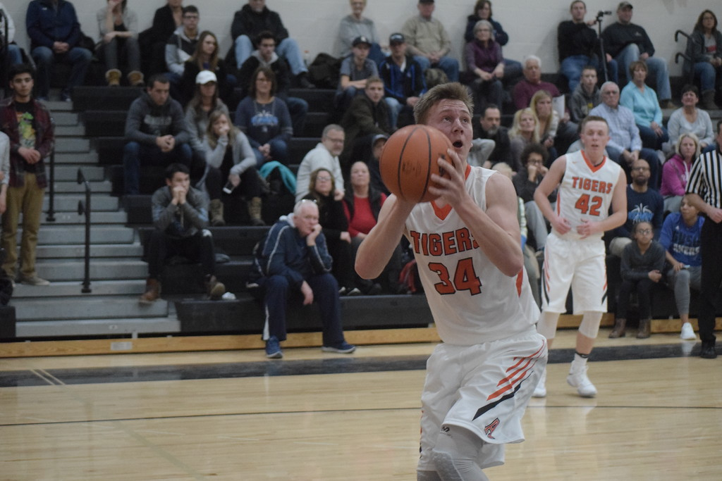 . Cameron Hart of Armada eyes the basket. The senior center scored 26 points. Armada defeated Richmond 55-44 in a key Blue Water Area Conference basketball game played on the Tigers\' floor Tuesday, Feb. 13.  THE MACOMB DAILY PHOTO GALLERY BY GEORGE POHLY