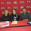 Shelby Bradford of Romeo signed with  Liberty University (Va.) hockey. She is pictured with her mother, Brenda, and father, Jim.