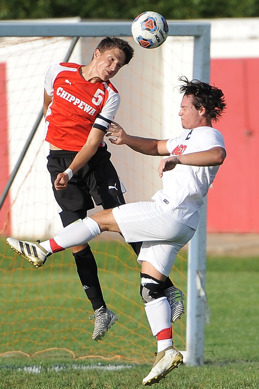 . Christian Margilaj (5) of Chippewa Valley heads the ball during the match between Romeo and Chippewa Valley on August 24, 2017.  THE MACOMB DAILY PHOTO GALLERY BY DAVID DALTON
