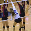 Kamryn Duffield (4) and Payton Klein (3) defend against a spike by Marissa Durand (10 of Eisenhower during the match between Eisenhower and Romeo at Eisenhower High School on October 20, 2016.  (MIPrepZone photo gallery by David Dalton)