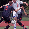 Ryan Danaj (6) of Romeo and Peter Milne (25) of Utica Battle for control of the ball during the match between Romeo and Utica at Utica High School  on August 27, 2016. (MIPrepZone photo gallery by David Dalton)