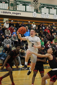 Dakota's Mark Tocco drives to the basket for a layup attempt during their Class A regional semifinal game against visiting Roseville on March 12, 2018. (Photo gallery by Kevin Lozon)