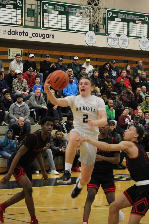 . Dakota\'s Mark Tocco drives to the basket for a layup attempt during their Class A regional semifinal game against visiting Roseville on March 12, 2018. (Photo gallery by Kevin Lozon)