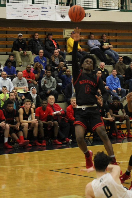 . Roseville\'s Martell Turner attempts a shot during its Class A regional semifinal game against host Dakota on March 12, 2018. (Photo gallery by Kevin Lozon)