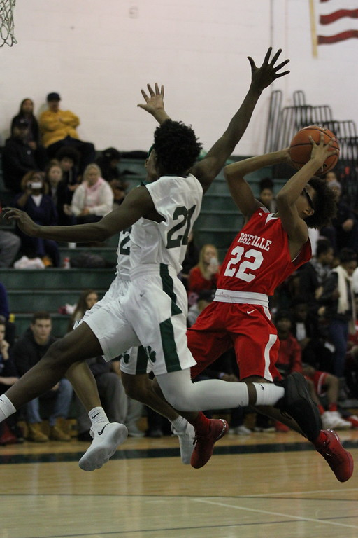. Isiah Collier-Foutz gets a shot off over 2 Eastpointe defenders. Roseville defeats Eastpointe 57-47 in a MAC crossover game played at Eastpointe on December 15, 2017. MACOMB DAILY PHOTO GALLERY BY GEORGE SPITERI