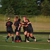 Powers players celebrate with Rachel Raisins (20) who scored the game winner in a 2-1 win over Lutheran North. (MIPrepZone photo gallery by Randy Castro)
